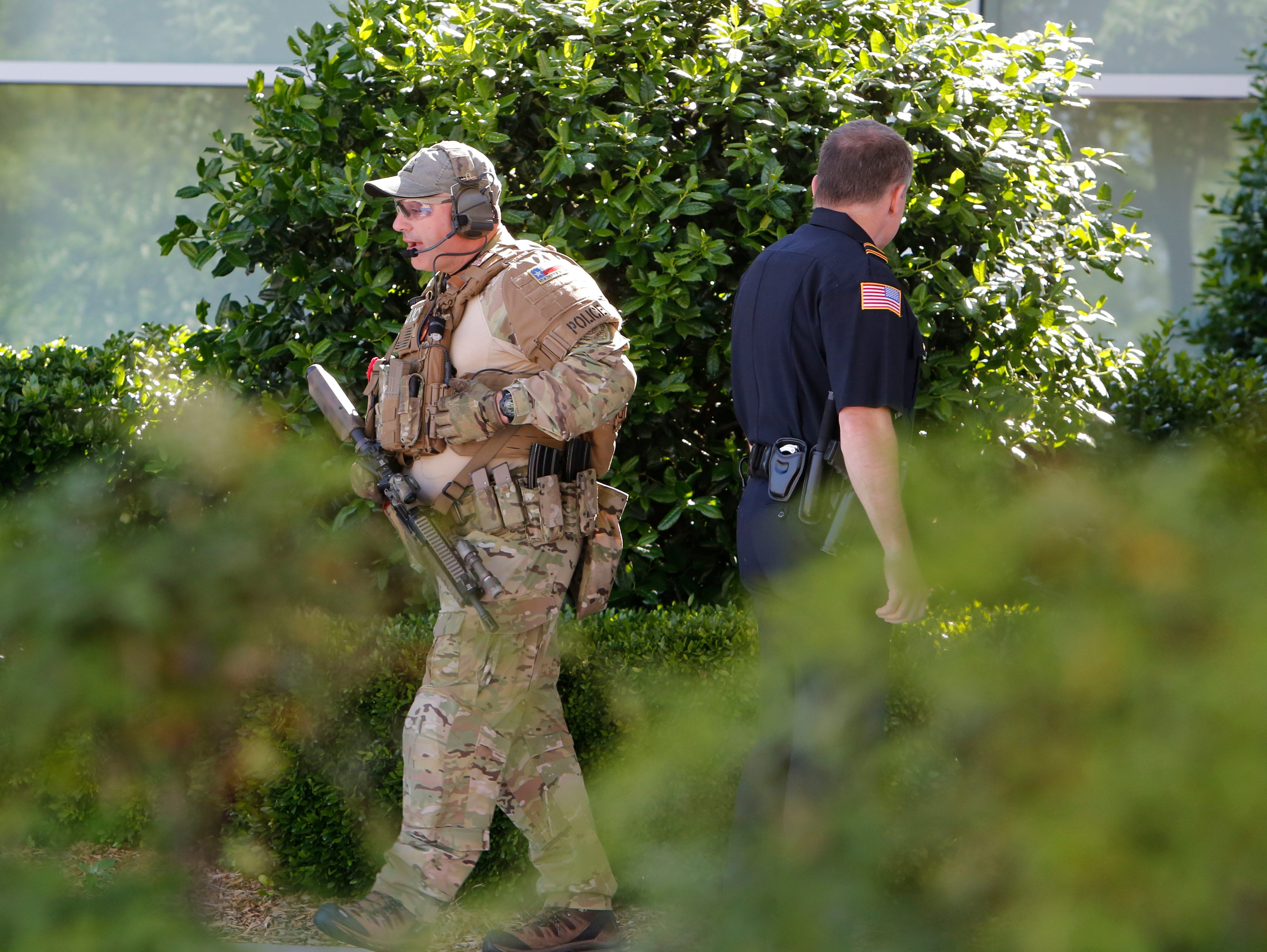 Officers patrol the perimeter of the Curtis Culwell Center in Garland, Texas. A contest for cartoon depictions of the prophet Mohammad in the Dallas suburb is on lock down after authorities reported a shooting outside the building.