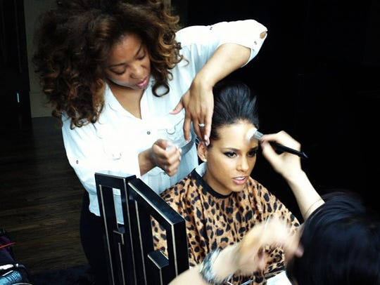 Celebrity hairstylist works on singer Alicia Key's