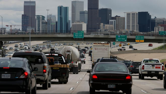 In this May 27, 2016 file photo, motorists guide their vehicles on Interstate 25, as the skyline of Denver rises in the background. The American Lung Association's 2017 clean air report released late Tuesday, April 18, 2017 says Denver has the nation's 11th-worst ozone levels. (AP Photo/David Zalubowski)