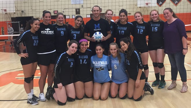 Mahwah coach Dean Rayside celebrating his 200th career victory with his team.