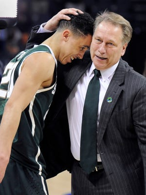 MSU head coach Tom Izzo hugs senior guard Travis Trice after MSU's 60-54 victory over Virginia last Sunday. Trice scored 13 of MSU's first 15 points and finished with 23.