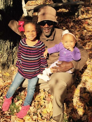 Bubba Jabbi with his daughters Nalia, 5, and Aisha, 1.