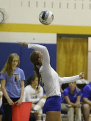 Trumansburg senior Brilynn Winkleblack attempts a serve on  Tusday against Harpursville.