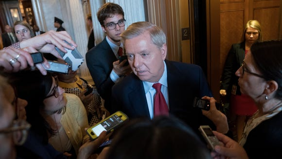 Sen. Lindsey Graham, R-S.C., talks with reporters after