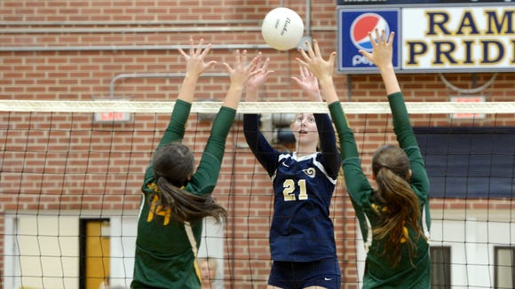 Abby Krueger, shown during a 2016 match, had two blocks, 10 kills and three aces in Roberson's 3-0 against East Henderson.