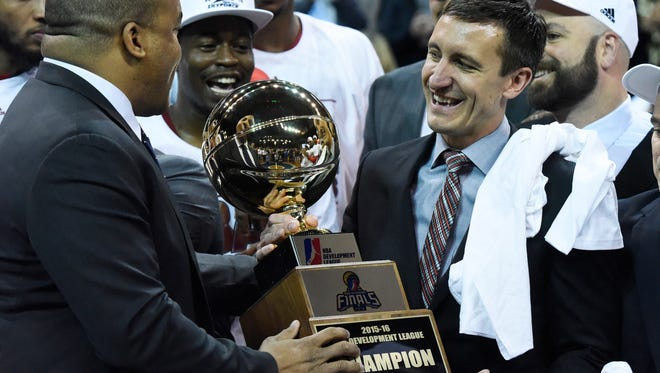 NBA D-League president, Malcolm Turner presents Skyforce team owner and president, Mike Heineman with D-League championship trophy following their 91-63 win over the L.A. D-Fenders Wednesday night at the Sanford Pentagon, April 27, 2016.