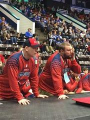 Glenn coaches Bill Polk and Mike Gaffke offer encouragement