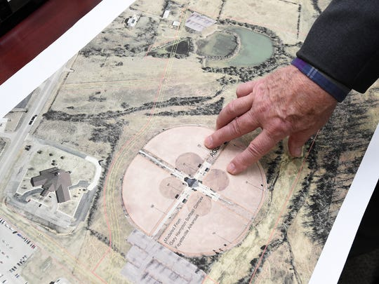 Mountain Home Mayor Joe Dillard looks over a map on Tuesday of an area near the west end of the Sheid-Hopper bypass where the city wants to build a new park.