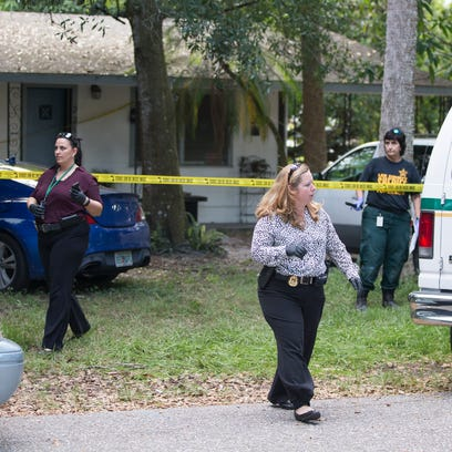 Lee County Sheriff detectives and crime scene technicians