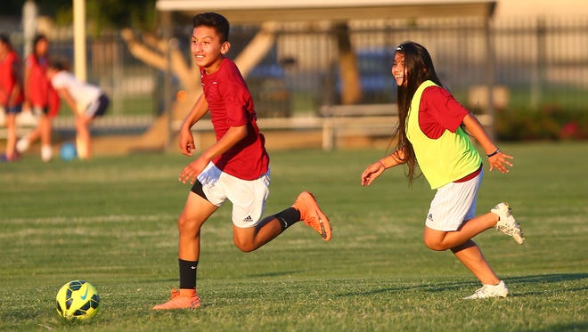 Rosie Sanchez, right, plays for the mostly boy soccer team La Laja.