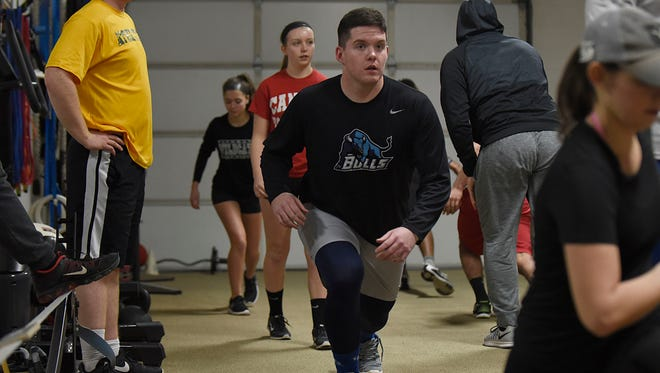 As part of a group of high school and college athletes at Jake's House of Iron, Jeremiah Riordan cranks up the intensity with each and every repetition.