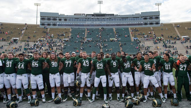 CSU football players celebrate after a 37-0 win over Fresno State on Nov. 5 at Hughes Stadium. The Rams accepted an invitation Sunday to play in the Idaho Potato Bowl on Dec. 22 in Boise.
