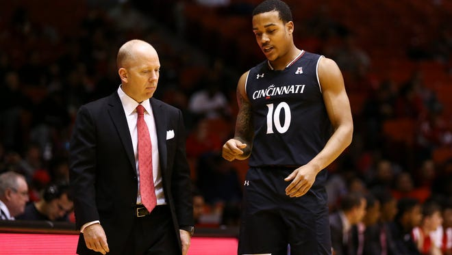 Cincinnati Bearcats guard Troy Caupain (10) talks with head coach Mick Cronin during the first half against the Houston Cougars at Hofheinz Pavilion.