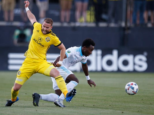 Columbus Crew defender Josh Williams (3) and Seattle Sounders forward Seyi Adekoya (12) vie for possession during the first half of an MLS soccer match Wednesday, May 31, 2017, in Columbus, Ohio. [Joshua A. Bickel/The Columbus Dispatch via AP)