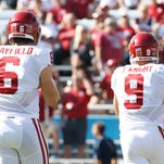 Oklahoma quarterback Trevor Knight (9) would like to be playing, but more than that, he wants the Sooners to win and starter Baker Mayfield to succeed.
