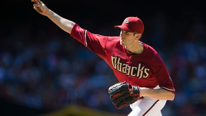 April 27, 2014 - Diamondbacks pitcher Brandon McCarthy throws against the Philadelphia Phillies during the seventh inning at Chase Field.