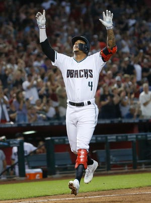 Diamondbacks Ketel Marte (4) celebrates after hitting a two-run home run against the Giants Andrew Suarez (59) during the first inning at Chase Field in Phoenix, Ariz. on Aug. 4, 2018.