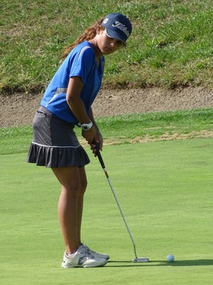 Lancaster's Vivian George gets set to hit a putt during the Division I sectional tournament at Westchester Golf Course last Tuesday.