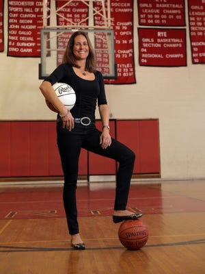 Former Rye girls basketball coach Mary Henwood, who helped advance girls athletics in Section 1. She retired in 2012 retired after 25 seasons with the team.   She is photographed in the gym at Rye High School in Rye on April 26, 2012.