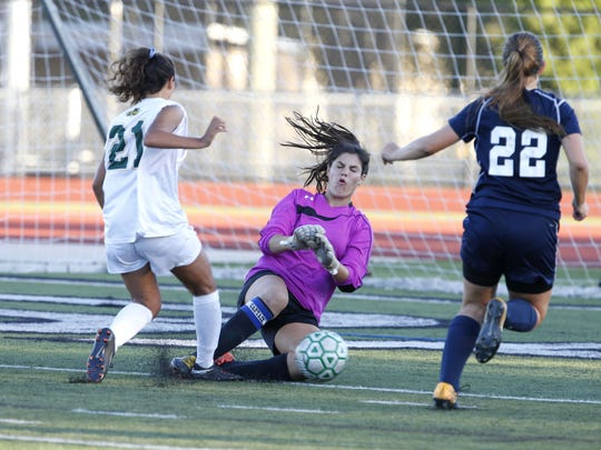 Middletown South goalkeeper Gabriella Cook (0) makes a save against Julianan Rafaniello (21) of Red Bank Catholic during girls high school soccer game at Count  Basie Park, Red Bank,NJ. Wednesday, October 4, 2017.  Noah K. Murray-Correspondent Asbury Park Press