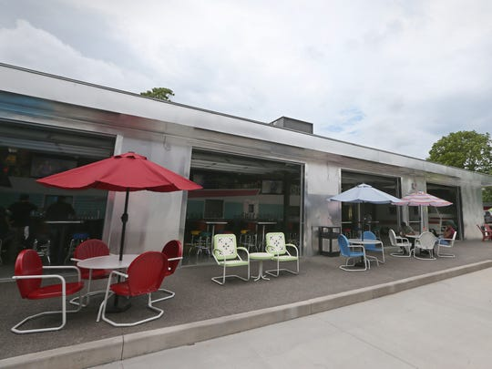 Table seating and a large paved outdoor space can be used by customers at Beer Park, a new craft beer bar near the South Wedge, at the corner of S. Clinton and Averill avenues in Rochester Thursday, May 31, 2018.