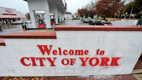 "The ""Welcome to York"" sign at a Turkey Hill in York"