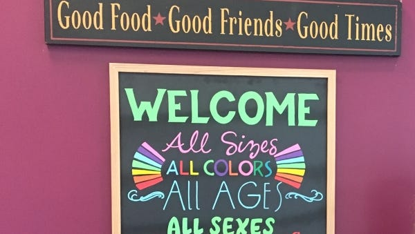 The welcome sign at Yassin's Falafel House is becoming a Knoxville icon.