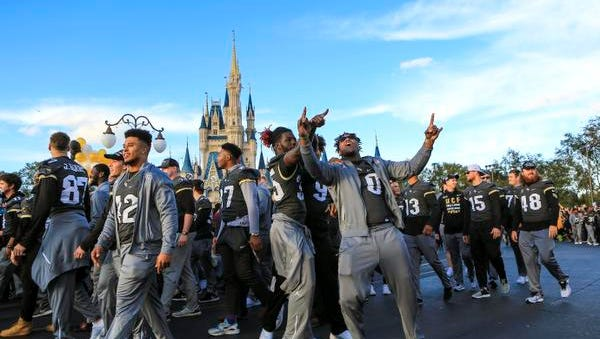 Central Florida football players celebrate during the a parade at Walt Disney World in the Magic Kingdom on Sunday, Jan. 7, 2018, in Orlando, Fla. (Jacob Langston/Orlando Sentinel via AP)