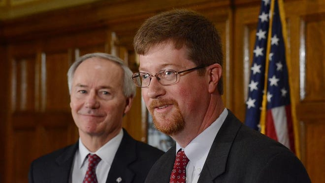 Gov. Asa Hutchinson introduces former Mountain Home state senator Johnny Key on Monday as his pick to be the state's Commissioner of Education.