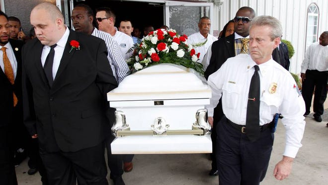 Pallbearers bring out the casket of Lorel Malone during funeral at Church on the Rock in Pascagoula.