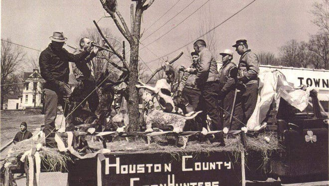 And old photograph of the Houston County Coon Hunters float in the Irish Day Parade. They used a live raccoon. From left are Ivan Averitt, Artic Tanner, Bill Clemmons, Oriental Rye, Arkley Elliott and Shotgun Rye.