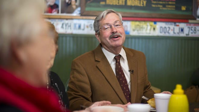 Gov. Terry Branstad has a laugh during lunch with friends and family at the Grand Cafe Tuesday, Nov. 24, 2015, in Lake Mills.