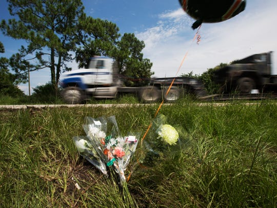 Flowers are laid at the scene where three people were killed in head on crash on State Road 82 near the intersection of Corkscrew Road. Driver Alex Garcia, 28, was killed in the crash along with five-year-old Alexis Garcia, 5.  Passenger Jenny Anzualda Garza, 28, and Jeremia Garcia, 10, suffered critical injuries, all are from Immokalee.  The driver of the second vehicle was killed and a passenger was critically injured.  They are both from Fort Myers.  It was the second of deadly crashes on State Road 82 in two days.  A motorcylist and his passenger were killed at the intersection of Alabama Road.