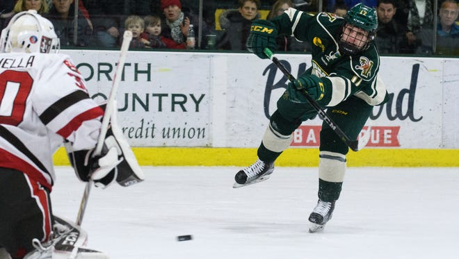 Vermont forward Drew Best (12) shoots the puck during the men's hockey game between the St. Lawrence Saints and the Vermont Catamounts at Gutterson Fieldhouse on Friday night December 29, 2017 in Burlington, Vermont.