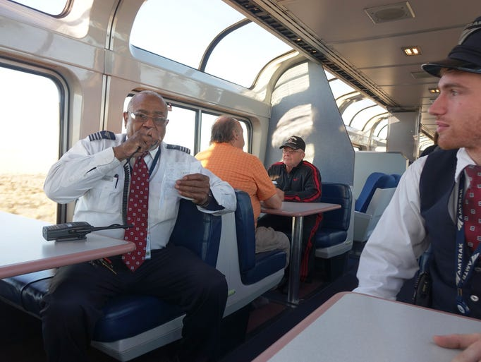 Amtrak conductor Billy Ray Pearson chats with the train's