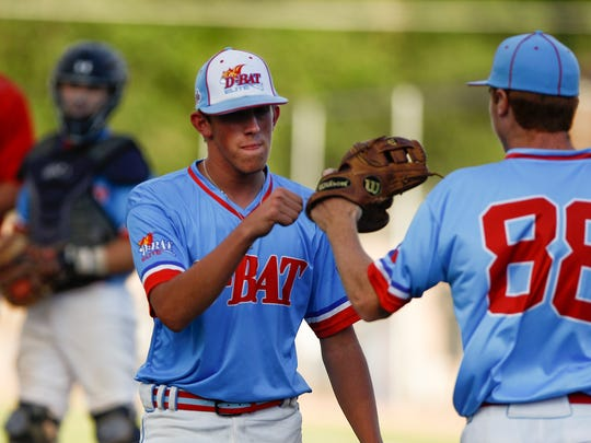 D-BAT 17 pitcher Kaden Krowka, left, is greeted by Hunter Dobbins during Game 8 of the Connie Mack World Series on Wednesday at Ricketts Park.