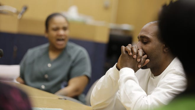 Mitchelle Blair screams at Alexander Dorsey, right the father of two of her children, saying that he is a drunk during a court appearance where the state is seeking to terminate their parental rights at the Wayne County juvenile court in Detroit on Wednesday.