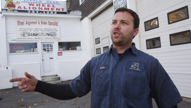 Brian Calabro discusses Sunday's Hudson River rescue effort at Little Bear Wheel Alignment in Buchanan on Monday, Nov. 9, 2015.