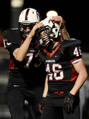 Pierz's Ted Dehler (73) hugs teammate Lane Girtz after