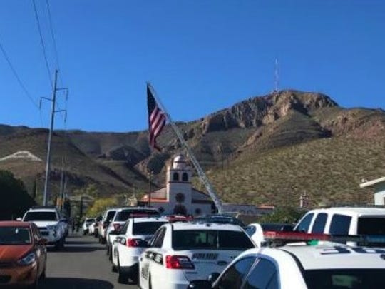 Vehicles from numerous law enforcement agencies in the borderland line the streets in front of Our Lady of Guadalupe Church in Central El Paso ahead of the funeral Mass for U.S. Border Patrol Agent Rogelio Martinez.