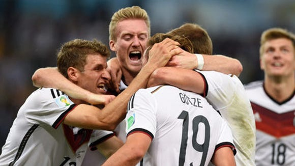 Germany celebrates with midfielder Mario Gotze (19) after he scored a goal against Argentina in the championship match of the 2014 World Cup at Maracana Stadium.