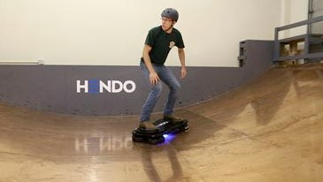 Arx Pax engineer Garrett Foshay demonstrates riding a Hendo Hoverboard in Los Gatos, Calif. Skateboarding is going airborne this fall with the launch of the first real commercially marketed hoverboard which uses magnetics to float about an inch off the ground.