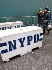 Concrete blocks rest Dec. 29, 2016, on a sidewalk in
