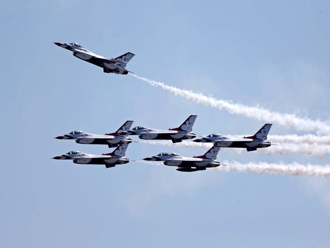 The U.S. Air Force Thunderbirds perform a flyover before