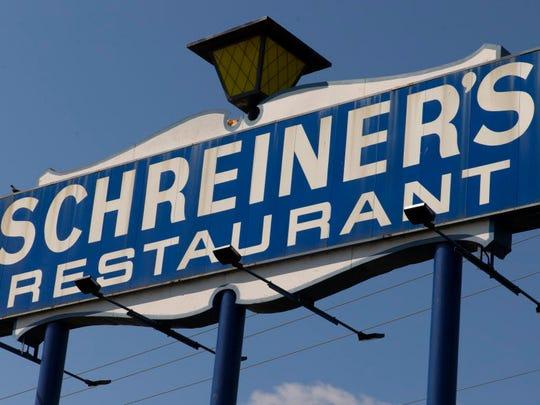 A sign at Schreiner's Restaurant in Fond du Lac beckons to motorists on I-41.