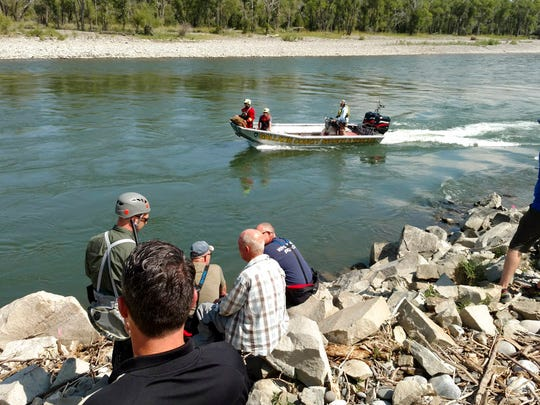 In this July 29, 2018, photo provided by The Gallatin County Sheriff's office, search and rescue teams along the Yellowstone River search for 15-year-old James Anderson, whose family's boat capsized near Livingston.