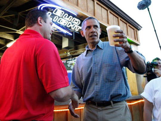 The Iowa State Fair even attracts the president. Here, President Barack Obama and Bud Light Booth owner Mike Cunningham II, left, make a toast during a campaign at the Iowa State Fair in Des Moines, Iowa, Monday, Aug. 13, 2012.