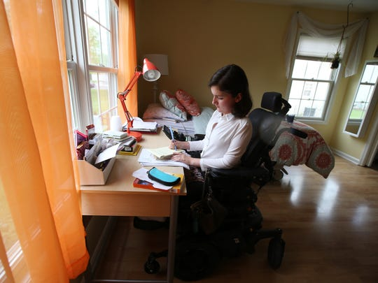 Anna Landre, last year's Freehold Township valedictorian and a Georgtown University student who is fighting for the rights of disabled workers in New Jersey, works at her desk in her bedroom at her home in Howell, NJ Wednesday May 16, 2018.