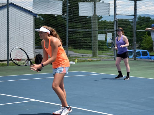 Turner Ashby's Emma Nesselrodt, left, and Fort Defiance's Ali Keister play a practice match against Riverheads' Grace Staton and Blake Bartley at Stewart Middle School in Fort Defiance, Va., on Tuesday, June 6, 2017. Staton and Bartley play in the VHSL Group 1A state semifinals in Radford on Friday.