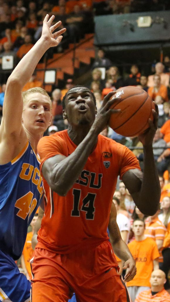 Oregon State senior forward Daniel Gomis (right) hasn't played yet this season due to a broken hand.